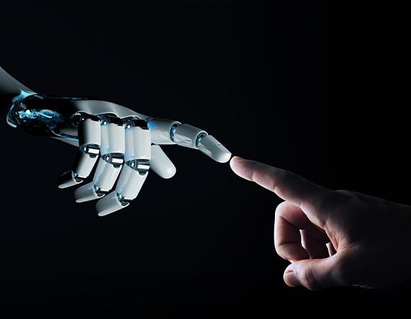 אצבע אנושית נוגעת באצבע רובוטית
